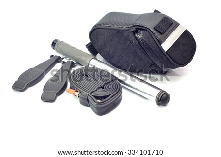 Emergency repair kits (bicycle pump, tube and tyre levellers) with saddle bag on a white background - stock photo