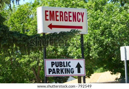 Emergency room and parking sign located in seom trees