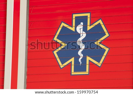 Emergency sign on side of the fire truck. - stock photo