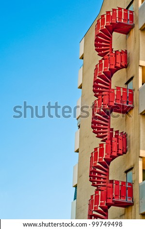 emergency stairs. fire escape outside building. urban architecture background - stock photo