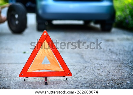 Emergency stop sign in background with  broken down car  - stock photo