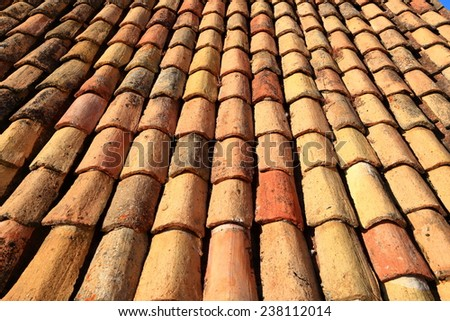 Emerging rows of ceramic tiles on a roof in Dubrovnik, Croatia - stock photo