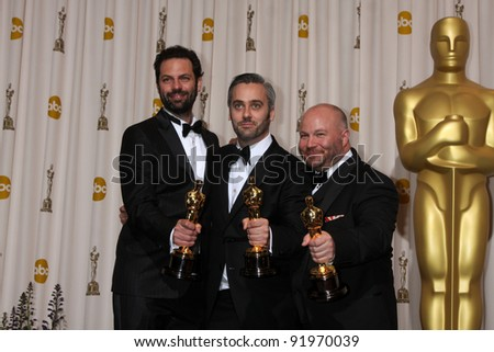 Emile Sherman, Iain Canning and Gareth Unwin  at the 83rd Annual Academy Awards Press Room, Kodak Theater, Hollywood, CA. 02-27-11