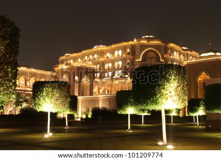 Emirates Palace Garden in the night. Abu Dhabi - stock photo