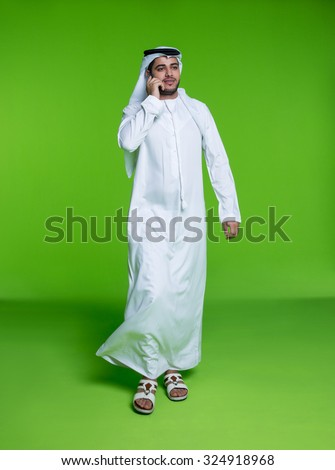 Emirati businessman talking on mobile - stock photo