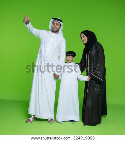 Emirati family looking with curiosity - stock photo