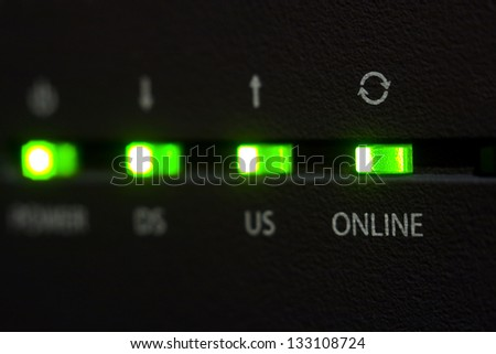 Emitting diode online on internet cable modem - stock photo