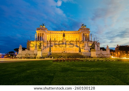 Emmanuel II Monument Rome at dusk. The Altare della Patria (Altar of the Fatherland) also known as the Monumento Nazionale a Vittorio Emanuele II in the day of beautiful sky. - stock photo