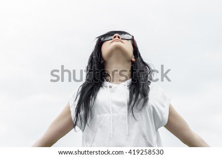 Emo girl stands and loves life with a sense of freedom - stock photo