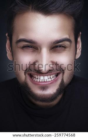 Emoticon Series in Studio with a Caucasian Guy - stock photo