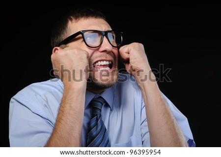 Emotion business man in glasses and the global financial crisis - stock photo
