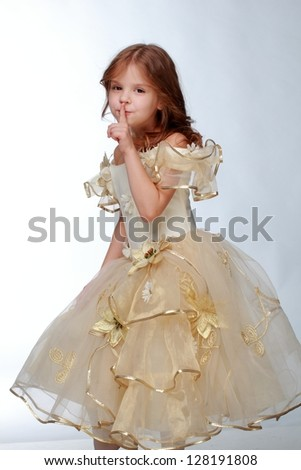 Emotion girl in beautiful dress on white background