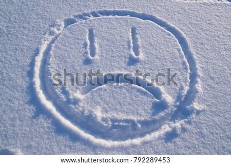 Emotion of a sad person on the snow