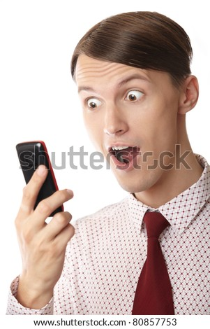 Emotional astonished businessman holding cell phone on a white background