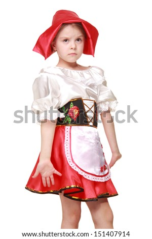 Emotional beautiful little girl dressed as fairy-tale characters in a red hat on a white background
