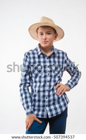 Emotional blond boy checkered shirt and straw hat on a white background