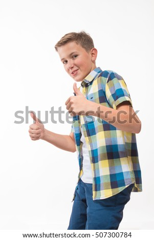 Emotional boy in a plaid shirt over a white background