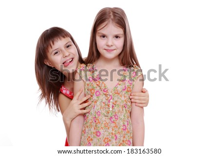 Emotional cheerful little girls posing on camera as a fashion models