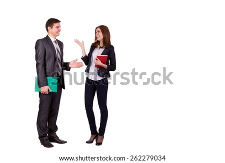 Emotional conversation. Young male and female, officially dressed, discussing and hand gesturing. Full body portrait on white background. - stock photo