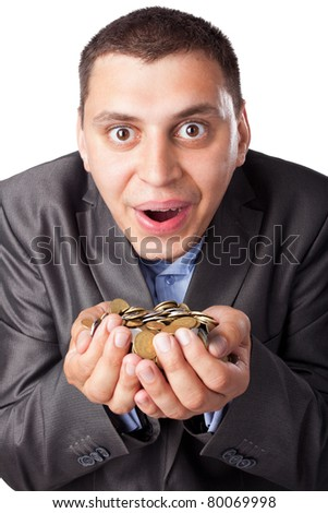 emotional crazy young businessman with heap of coins isolated on white background