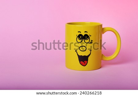 Emotional cup on pink background - stock photo
