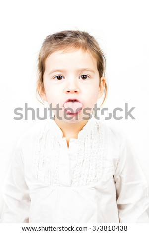 Emotional facial Expression of little girl - showing tongue