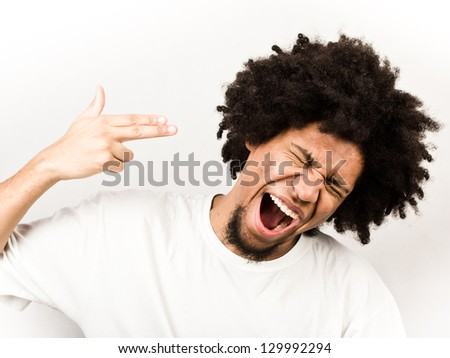 Emotional facial expression of man - suicide - stock photo
