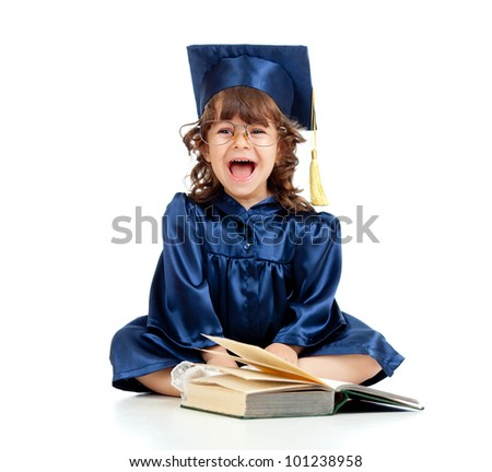 Emotional funny child in academician clothes  with book - stock photo