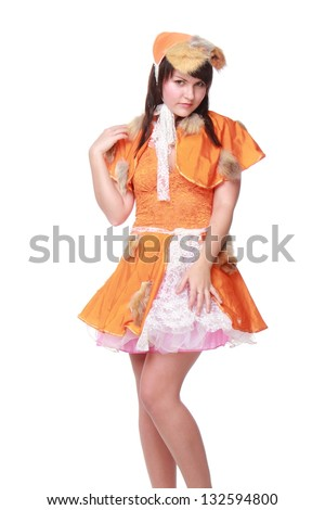 Emotional girl in an orange dress and hat on white background