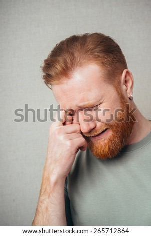 Emotional handsome Young hipster red bearded  crying - stock photo