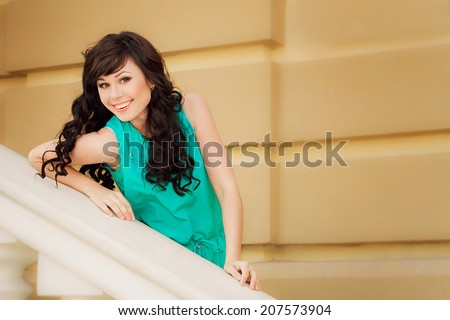 Emotional happy smiling brunette girl in cyan costume - stock photo