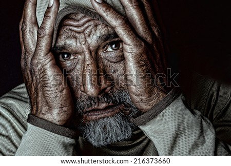 Emotional Image of a  Indian man on Black - stock photo