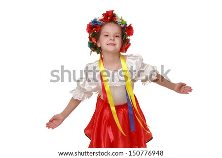 Emotional little girl in a beautiful Ukrainian costume on a white background on Beauty and Fashion