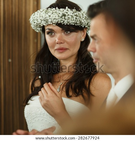 emotional luxury cute bride on the background hotel room - stock photo