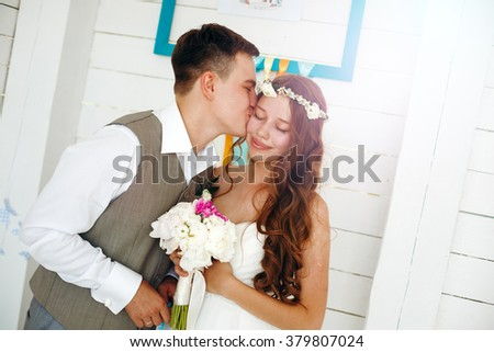 Emotional Moment of Wedding Day. Beautiful Newlywed Couple. Groom Kissing His Bride. - stock photo