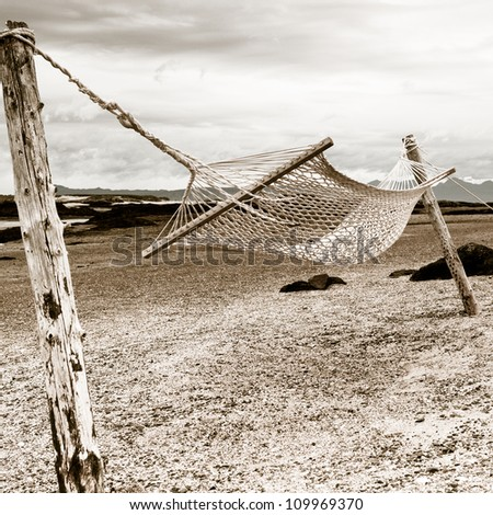 Emotional picture of Hammock on Morar beach, Scotland - stock photo