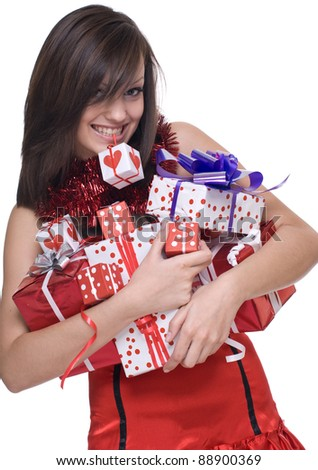 Emotional playful woman  in santa claus dress, white fur and some gifts - stock photo