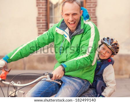 Emotional portrait father with cycling by bicycle together - stock photo