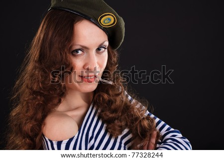 Emotional portrait of a girl in a vest and a military beret - stock photo