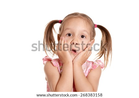 Emotional portrait of a little girl in a pink dress - stock photo