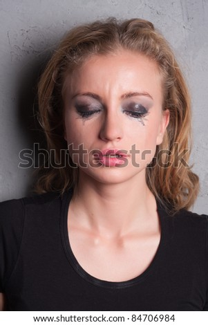 emotional portrait of a young  crying  girl