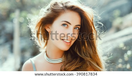 emotional portrait of Fashion stylish portrait of pretty young hipster blonde woman,going crazy,elegant black hat,soft colors,cool crazy girl.Red urban wall background.surprised girl close up - stock photo
