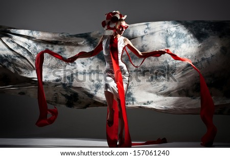 emotional portrait of fashion woman in exclusive dress posing in studio  - stock photo