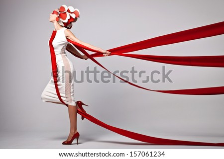 emotional portrait of fashion woman in exclusive dress posing in studio , expression - stock photo