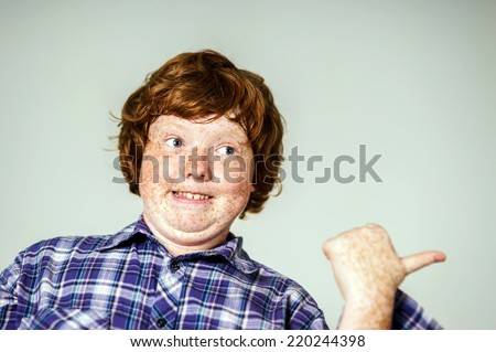 Emotional portrait of red-haired boy, attractive for advertising - stock photo