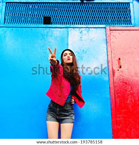 Emotional portrait of the beautiful girl on a blue background - stock photo