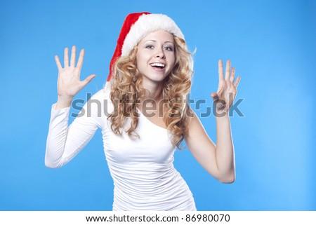 Emotional pretty Santa girl - stock photo