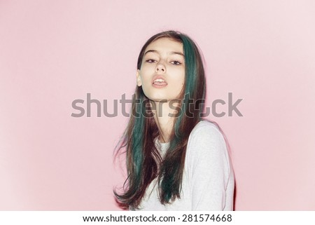 Emotional pretty young hipster girl make funny face on pink background - stock photo