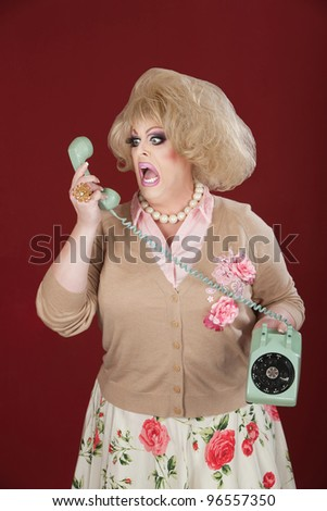 Emotional queen screams at a rotary telephone