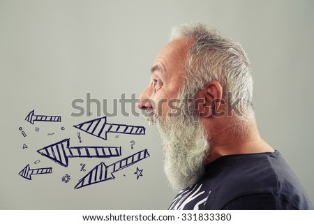 emotional senior man screaming. drawed arrows and symbols - stock photo